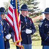 Indiana State Police color guard hold the flags during the memorial service Wednesday at Indiana State Police Toll Road District Post 21 located at 52422 County Road 17 in Bristol.