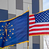 The American flag, Indiana flag, and the Indiana State Police flag blow in the wind during the memorial service Wednesday at Indiana State Police Toll Road District Post 21 located at 52422 County Road 17 in Bristol.