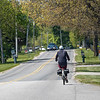 An Amish cyclist travels along the 13000 block of County Road 22 Thursday in Middlebury.