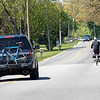 A vehicle passes an Amish cyclist along the 13000 block of C.R 22 Thursday in Middlebury.