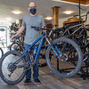 Pumpkinvine Cyclery owner Spencer Short showcases a high end bike at his shop Thursday in Middlebury.