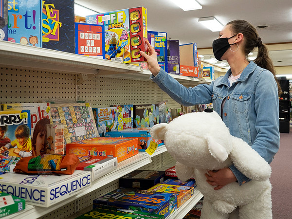 Abigail Horton, of Brentwood, Tennessee, shops for family games at The Depot Friday in Goshen.