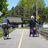Amish cyclists make a stop near the Dairy Queen along the Pumpkinvine Nature Trail Thursday in Middlebury.