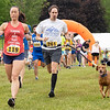 Stacey Marsh (119) and Timothy Murray (261) run in the <br /> 2021 Paws for a Cause 5K & 1 Mile Strut your Mutt – Run/Walk event Saturday at  Oxbow Park in Goshen.