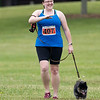 Jordan Lloyd (407) reacts while she approaches the finish line in the 2021 Paws for a Cause 5K & 1 Mile Strut your Mutt Ð Run/Walk event Saturday at  Oxbow Park in Goshen.
