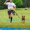Timothy Murray (261) reacts while he crosses the finish line with his dog in the 2021 Paws for a Cause 5K & 1 Mile Strut your Mutt Ð Run/Walk event Saturday at  Oxbow Park in Goshen.