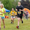 Kelly Bloode (241), Aslinn Kamerer (162), and Niall O'Regan (251) run in the 2021 Paws for a Cause 5K & 1 Mile Strut your Mutt – Run/Walk event Saturday at  Oxbow Park in Goshen.