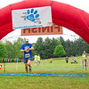 Eric Chris (268) runs across the finish line in the 2021 Paws for a Cause 5K & 1 Mile Strut your Mutt – Run/Walk event Saturday at  Oxbow Park in Goshen.