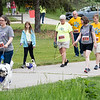 Jennifer French (493), Julie Dijkstra (456), David Veron (425), and Ashley Landis (427) walk along the 1 mile trail portion in the 2021 Paws for a Cause 5K & 1 Mile Strut your Mutt – Run/Walk event Saturday at  Oxbow Park in Goshen.