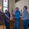 Vangie Harrer, left, Tim Harrer, and Kierstin Harrer lead participants in song at Goshen First Brethren Church Thursday during the National Day of Prayer event located at 215 West Clinton Street in Goshen.