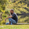 Mike Mikel, of Millersburg, sits on the embankment of the Baintertown Dam Thursday at Baintertown Dam ‒ River Preserve County Park in Goshen.
