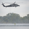 The Indiana Army National Guard pilots a VH60L helicopter during the U.S. Army's Indiana Helicopter Aquatic Rescue Tream training exercise at Fiddler Pond Wednesday in Goshen. The rescuer's name is Rescue Technician Steve Pritz who is holding onto the cable from the helicopter.