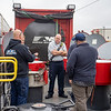 Response Management Services owner Austin Michaels, left, speaks with Cleveland Township Fire Chief Mike Graham and his crew members about various seals they could encounter on a tank car in a train derailment Tuesday during Norfolk Southern's Operation Awareness and Response program at the Elkhart Rail Yard.