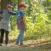 Miriam Kiogima, left, points towards the Elkhart River bank while walking with Lola Jenkins, both of Goshen, along the Shanklin-Mullet Trail Wednesday in Goshen.