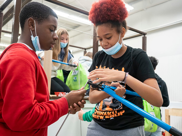 Javion Brown, 13, left, and Antoineayia McDonald, 14, both of Elkhart, work together to assemble a portion of railing Tuesday during manufacturing day at StairSupplies/Viewrail manufacturing facilities at 1753 Eisenhower Dr. North, Goshen. Please visit our website: ww.goshennews.com for a related video and photogallery from the event.