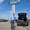 Eby Ford Lincoln Sales Consultant Arron Knisley showcases a Ford Explorer XLT  Monday at the dealership located at 2714 Elkhart Rd in Goshen.