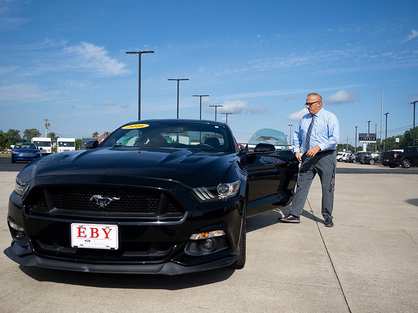 Eby Ford Lincoln Sales Consultant Arron Knisley showcases a 2016 Ford Mustang Monday at the dealership located at 2714 Elkhart Rd in Goshen.