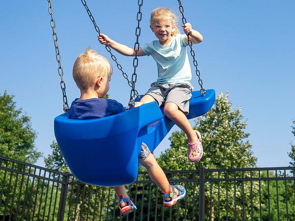 Nolan Farrell, 2, left, swings with his sister Ella Farrell, 4, both of Goshen, Tuesday at Hay Park in Goshen.