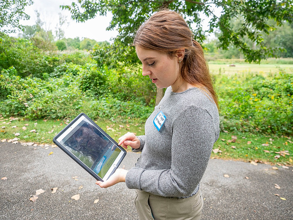 Naturalist Chloe Taylor demonstrates how to use the app for The Ashley Van Vurst Sensory Trail  during a ribbon cutting ceremony and grand opening of the The Ashley Van Vurst Sensory Trail Tuesday at Abshire Park in Goshen.