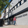 Joseph Weiser   The Goshen News<br /> Peter Claassen, of Goshen, walks along the sidewalk on South Main Street in front of The Goshen News building Friday afternoon. The renovation of the front exterior of building was completed a week ago. The public can now resume accessing the office through the front entrance.