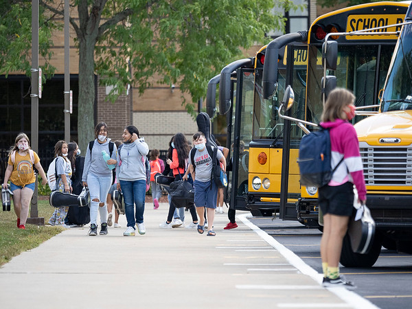 Goshen Community Schools students switch buses at the end of the school day Wednesday at Goshen Middle School.
