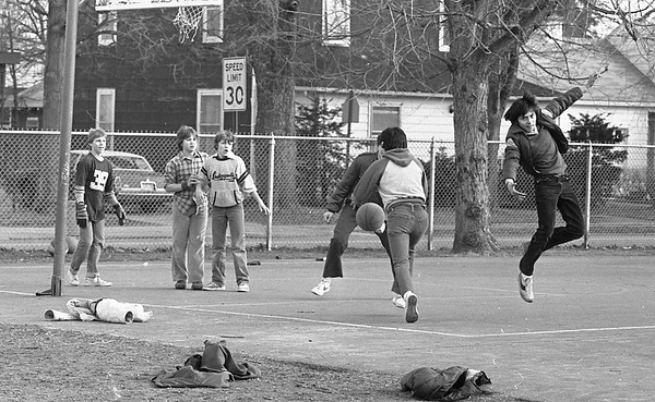 These boys may have more interest in Big 10 basketball than professional football as they play in a pickup game at Chandler School during Superbowl weekend. A year ago and five years ago young people were unable to play football outside, let along find a clear court for outdoor basketball. A record storm dumped heavy snowfalls on the Midwest five years ago at the end of January, and one year ago today Goshen received six inches of show, on top of a few feet of base that helped set records last year. Lores Steury, Goshen College weather observer, said today the snowfall for January will be well below normal this year. There has been only four inches of snow all season, but that melted shortly after it fell. Goshen News Photo, taken 1-29-83