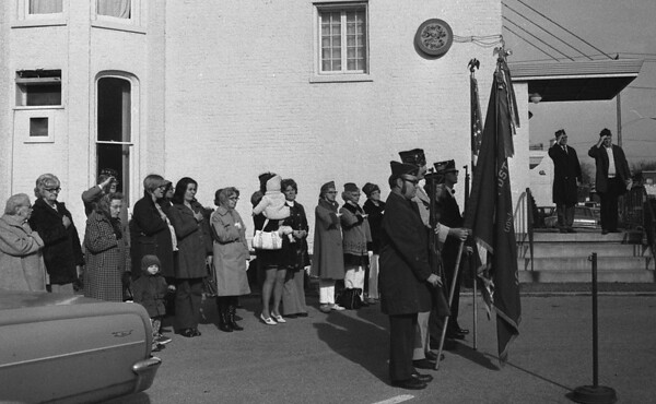 THE GOSHEN NEWS | November 11, 1973<br /> A number of spectators gathered in front of the Goshen American Legion Home Sunday at 10:45 a.m. to observe a memorial ceremony held by a veterans honor guard in honor of veterans who have served since World War I. Post 30 holds the ceremony each year. City, county, and state offices and schools were closed here today in observance of the holiday.