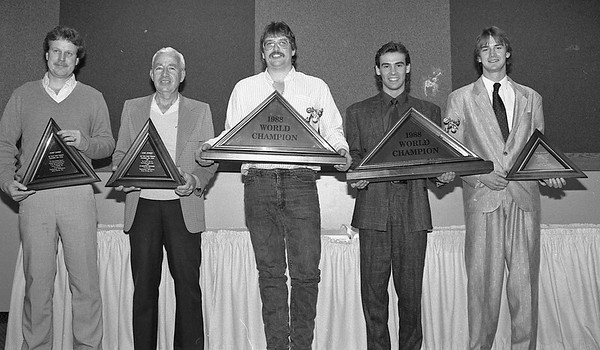 The Goshen News Jan. 9, 1989<br /> Pro motorcycle champs<br /> Jeff Yoder, Goshen, center, the 1988 natonal champion pro motorcycle hill climber, and other pros were honored at a banquet held at the Holiday Inn here Saturday night. Yoder, riding a Harley-Davidson out of Louis Gerencer's shop, Elkhart, will be out to defend his title this coming spring in the first event sponsored by the Goshen Iron Horsemen Motorcycle Club's gruonds northeast of Middelbury. From left are Randy Gabriel, Dublin, Ohio, Harley-Davidson and No. 3 rider, Earl Bowlby, Logan, Ohio, veteran BSA rider and national champion who was runner-up last season; Yoder, and smaller-bore riders Tim Frazier, Lancaster, Ohio, BSA and No. 1 rider; and Greg Williams, Markham, Ontario, Canada, Honda, runner-up.