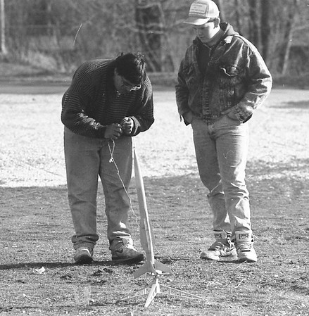 TROY HILL, THE GOSHEN NEWS | March 2, 1992<br /> These Two young men took advantage of sunny weather in Goshen Saturday to launch model rockets. At left is Jame Detwyler, 15, and Jason Charles, 14, is at right. The two had several successufl launces at Shanklin Park before technical difficulties grounded them for the day.