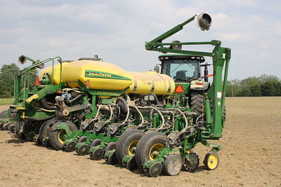 HALEE HEIRONIMUS / GAZETTE The equipment used to plant crops in a field in Penfield Township.