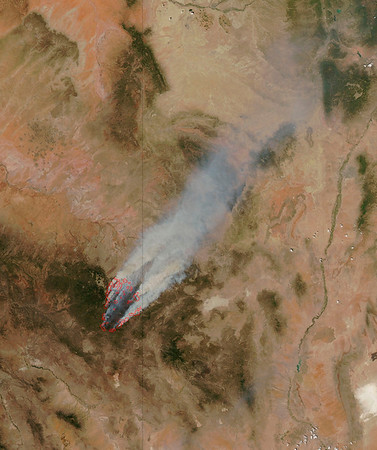 Arizona Wildfires.JPEG-0113.JPG This image provided by NASA shows the Wallow fire in eastern Arizona taken Wednesday June 8, 2011 from the MODIS instrument on board the Aqua satellite. The blaze has blackened about 389,000 acres and destroyed 11 buildings, primarily in the Apache-Sitgreaves National Forest. No serious injuries have been reported. (AP Photo/NASA)