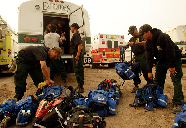 Arizona Wildfires.JPEG-03aa.JPG The Navajo Hotshots, out of Fort Defiance, Ariz., prepare to leave for the firelines to fight the Wallow Fire at an incident command center in Eagar, Ariz., Thursday, June 9, 2011. (AP Photo/Marcio Jose Sanchez)