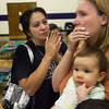 Arizona Wildfires.JPEG-09ad.JPG From left, Amelia Hernandez of Eagar, Ariz.   talks to Becky Coffman, of Springerville  who holds her daughter, Ember Coffman, 10- months, at the evacuation center at Blue Ridge High School in Lakeside, Ariz.  on Thursday, June 9, 2011.   The American Red Cross set up a shelter at the high school.   Both Hernandez   and Coffman   had to evacuate their homes because of the Wallow Fire.    Several mountain communities have emptied in advance of the fire, and a utility that supplies power to customers in southern New Mexico and west Texas issued warnings of possible power interruptions.  (AP Photo/The Arizona Republic,  David Wallace)