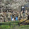 Members of a U.S. Army Reserve Urban Augmentation Medical Task Force are gathered on the grounds of Tewksbury Hospital Tuesday morning, where patients and staff have tested positive for COVID-19.  (SUN/Julia Malakie)
