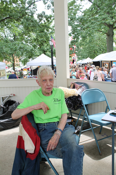 LAWRENCE PANTAGES / GAZETTE Jo-Ann Rettig-Rau's observation post for the 43rd Art in the Park event that attracted thousands to Public Square in Medina on Sunday was the gazebo. Rettig-Rau served as chair for the event that featured the work of 130 exhibitors.