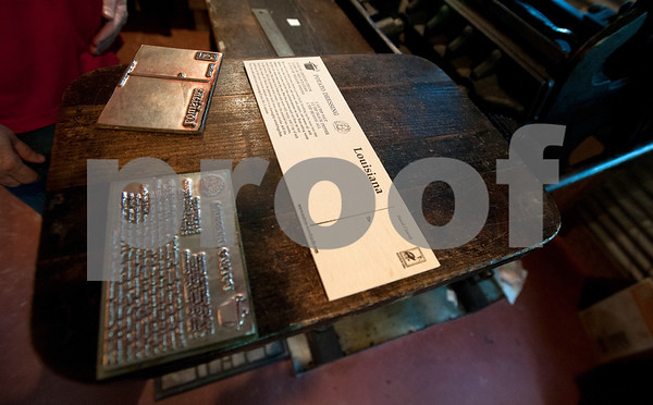 Recipe cards are one of the types of items David Jones and Denys Smith of Hideaway create with a 1898 Chandler Price printing press.  (photo by Sarah A. Miller/Tyler Morning Telegraph)
