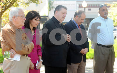 photo by Sarah A. Miller/Tyler Morning Telegraph  Local clergy gather on the square in downtown Tyler for the Art of Peace Festival's Prayer on the Square event Thursday afternoon. Pictured from left to right are: Rev. Max Lafser of Tyler Unity Center, Rev. Allison Thompson of Pleasant Retreat UMC, Fr. Tim kelly of St. Mary Magdalene Catholic Church, pastor Stuart Baskin of First Presbyterian Church and  East Texas Islamic Society outreach coordinator Anwar Khalifa. The festival continues Saturday with a Peace Art display at Gallery Main Street during the ArtWalk from 4-8pm, and Sunday with a peace service held at Unitarian Universalist Fellowship of Tyler.
