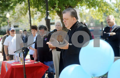 photo by Sarah A. Miller/Tyler Morning Telegraph  Father Tim kelly of St. Mary Magdalene Catholic Church in Flint leads a prayer on the square in downtown Tyler for the Art of Peace Festival's Prayer on the Square event Thursday afternoon.The festival continues Saturday with a Peace Art display at Gallery Main Street during the ArtWalk from 4-8pm, and Sunday with a peace service held at Unitarian Universalist Fellowship of Tyler.