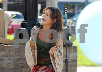 "photo by Sarah A. Miller/Tyler Morning Telegraph  Diane Gatewood of Tyler sings ""Let there be Peace on Earth"" on the square in downtown Tyler for the Art of Peace Festival's Prayer on the Square event Thursday afternoon. The festival continues Saturday with a Peace Art display at Gallery Main Street during the ArtWalk from 4-8pm, and Sunday with a peace service held at Unitarian Universalist Fellowship of Tyler."