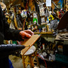 KRISTOPHER RADDER — BRATTLEBORO REFORMER<br /> Art Costa, of Putney, puts hot glue on a piece of cardboard before putting it on his sculpture.