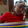 KRISTOPHER RADDER — BRATTLEBORO REFORMER<br /> Melody Squires, of Guilford, who has cerebral palsy, works on a painting with help from Ross Smart, a teacher at the River Gallery School.