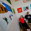 KRISTOPHER RADDER — BRATTLEBORO REFORMER<br /> Melody Squires, of Guilford, and River Gallery School teacher Ross Smart look at some of the painting that Squires created.
