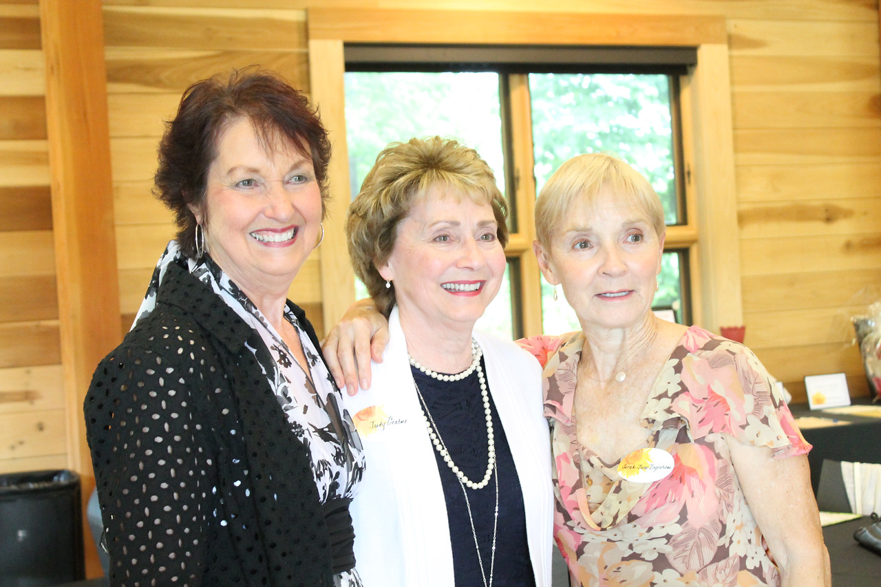 LAWRENCE PANTAGES / GAZETTE Sarah Jane Ingraham, right, was an honoree Thursday night during an event called the Summer Soiree and Service to the Arts program held at Allardale Park Lodge in Hinckley. Ingraham, a former art teacher who now works with seniors, is shown with friends Elaine Lamb, left, and Judy Graber.