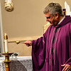 KRISTOPHER RADDER - BRATTLEBORO REFORMER<br /> Father Justin Baker, of St. Micheal's Roman Catholic, blesses the ashes before giving them out during Ash Wednesday  on Wednesday, March 1, 2017.