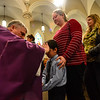 KRISTOPHER RADDER - BRATTLEBORO REFORMER<br /> Father Justin Baker, of St. Micheal's Roman Catholic Church in Brattleboro, Vt., gives ashes to Ethan Dickinson during Ash Wednesday service on Wednesday, March 1, 2017.