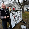 """KRISTOPHER RADDER - BRATTLEBORO REFORMER<br /> Rev. Peggy Yingst, of the Trinity Lutheran Church in Brattleboro, Vt., gives ashes  during an """"Ashes to Go"""" event on Wednesday, March 1, 2017."""