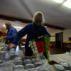 KRISTOPHER RADDER — BRATTLEBORO REFORMER<br /> Seven volunteers from Guilford Cares Food Pantry make 30 Thanksgiving baskets for local families at the Broad Brook Community Center, in Guilford, on Monday, Nov. 25, 2019.