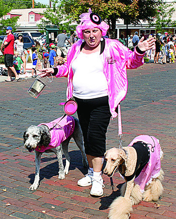 """The Pink Ladies"" walked in the 2013 Zionsville Fall Festival parade. The parade's theme was ""Rock Around the Clock."""