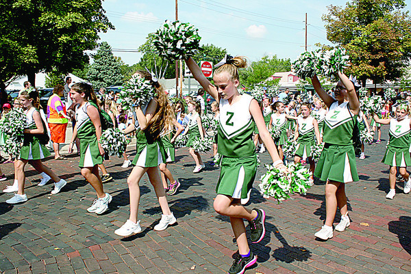 ZYFL cheerleaders show their spirit in the 2013 Zionsville Fall Festival parade.