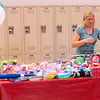 Erin Lee, human resource manager at UTi Logistics, unveils a load of Christmas toys to be donated to the Boone County Toy Drive. UTi Logistics is helping Lebanon resident Myrtle Bailey recover toys that were damaged after an early morning flood in April. The company had a kickoff event for their fundraiser Tuesday afternoon, Aug. 6.